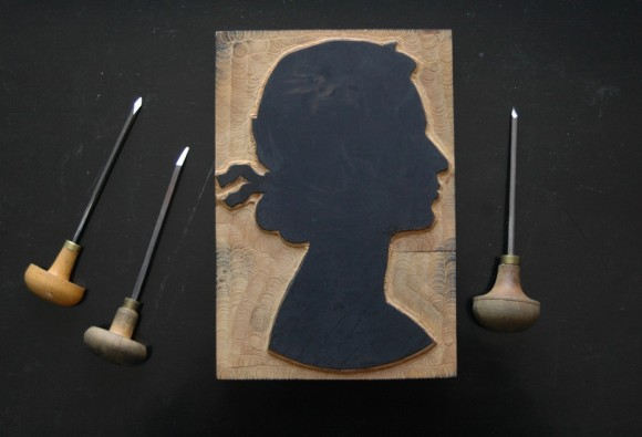 Gentleman's woodcut of the Queen's silhouette, after the then current coinage head designed by Mary Gillick